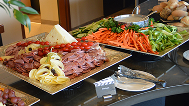 Meat, cheese, vegetable and fruit plates.