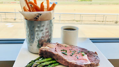 prime rib with asparagus and sweet potato fries