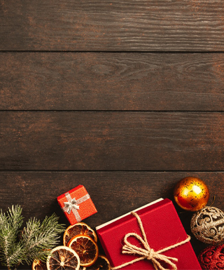 presents and ornaments on dark wood background